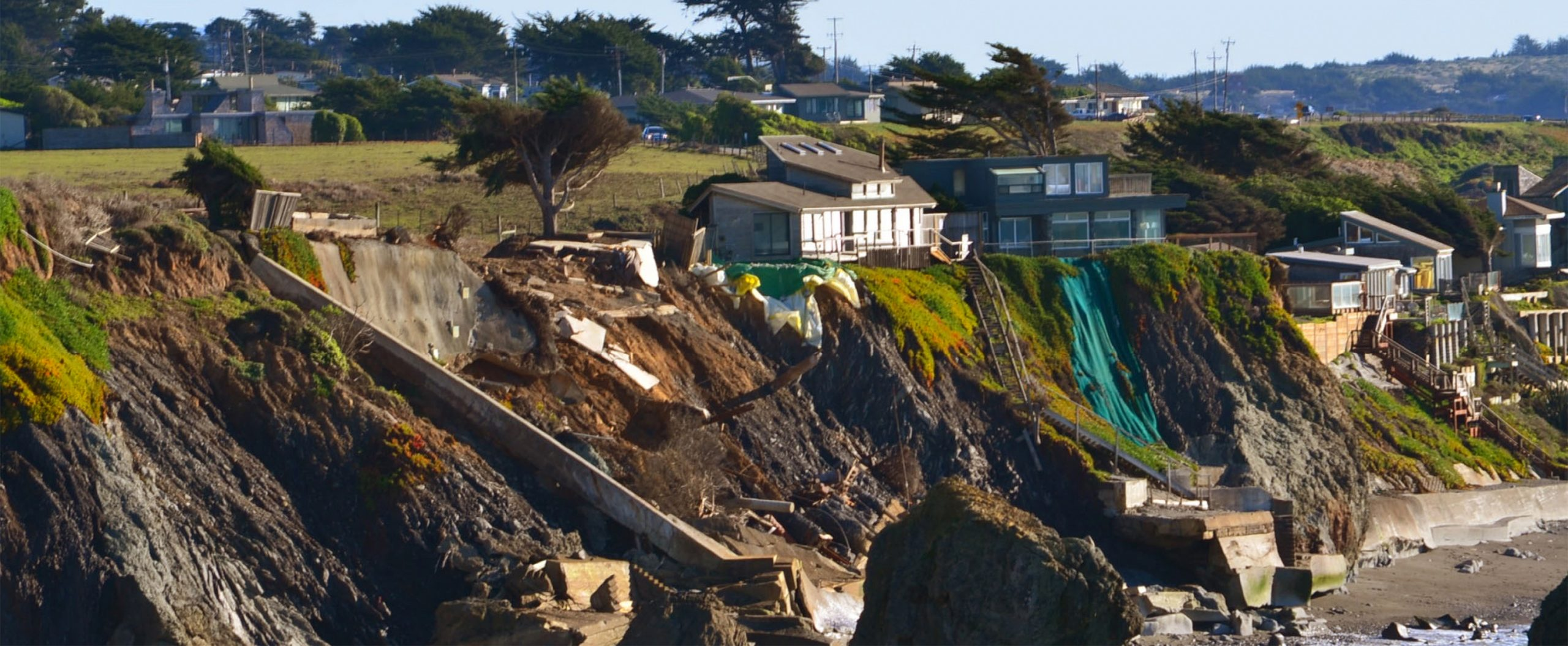 Photo of coastal erosion progressing.